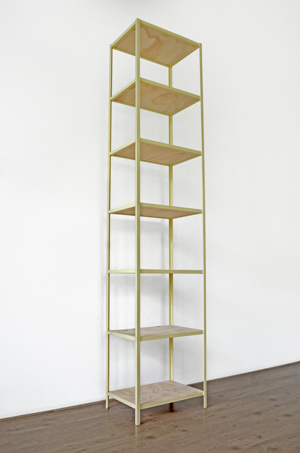 Metal welded frame from L profile with plywood planks. Can be used as a bookshelf or just for storage or display.