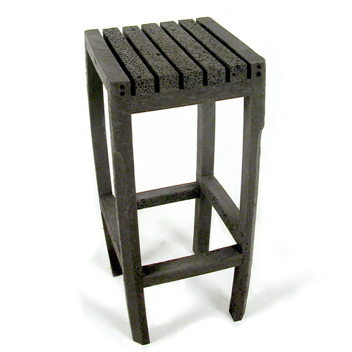 A bar-stool made from recycled barrier-posts. Because the inside of the posts is lighter and has a different tension than the outside the material bends slightly after being cut, this is what gives the stool its form. The bubbled structure inside the post is created during the production process when the plastic is injected into the mold. (recycled PET h:75 w:35 d:35 cm )
